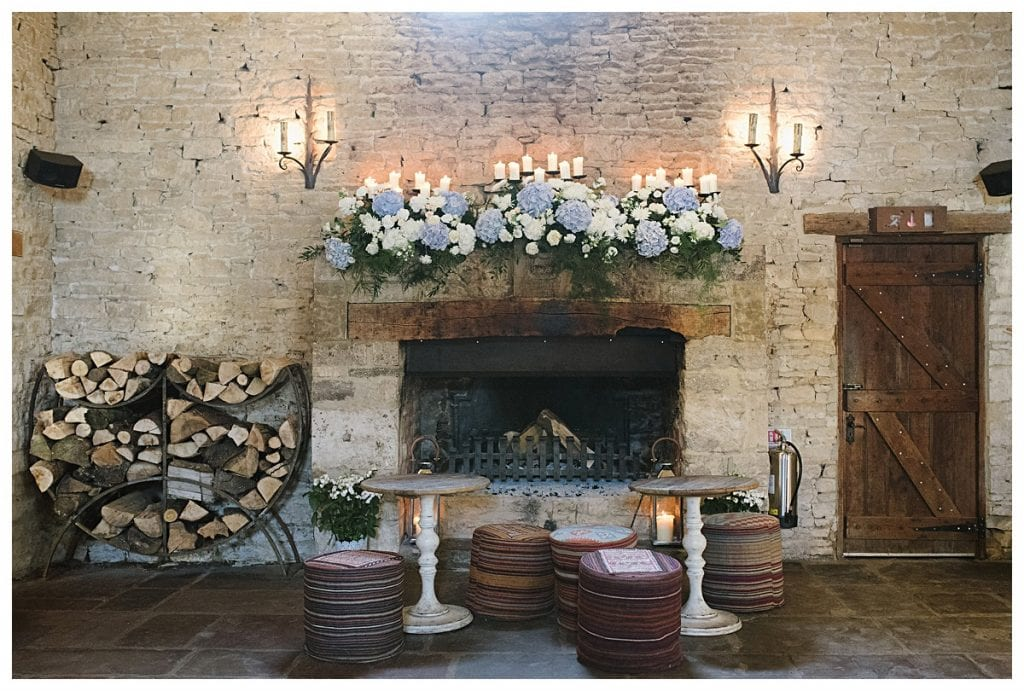 Fireplace at Cripps Barn decorated with flowers