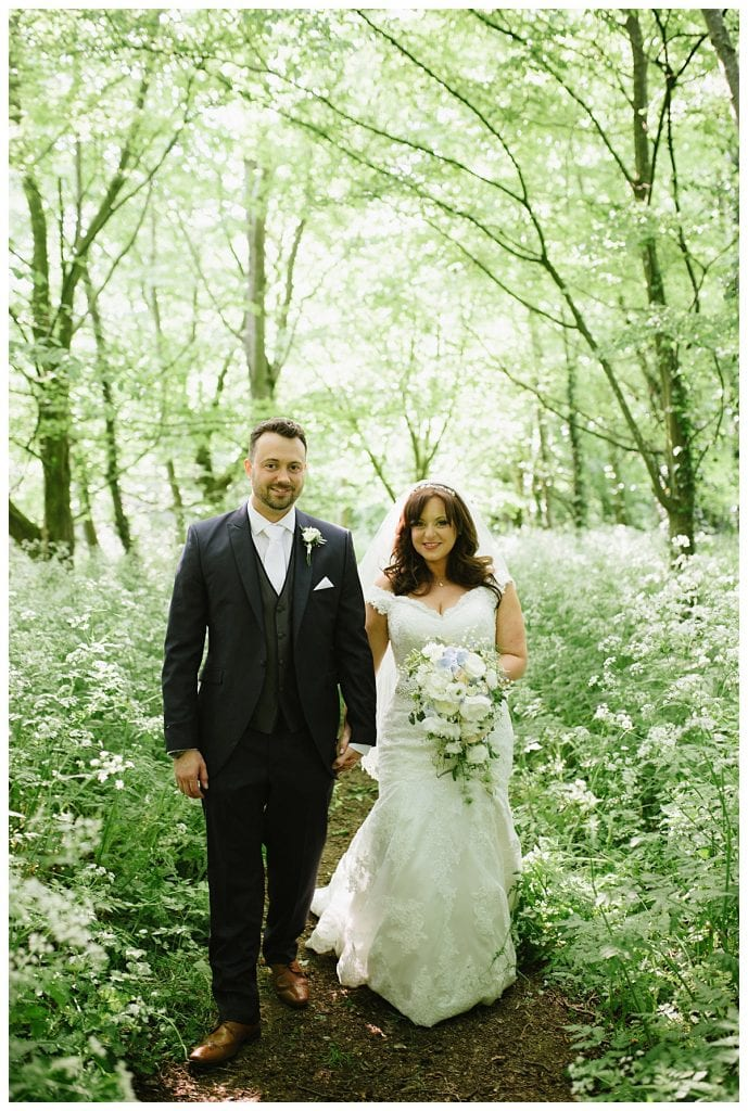 Bride and Groom in woodlands at Cripps Barn