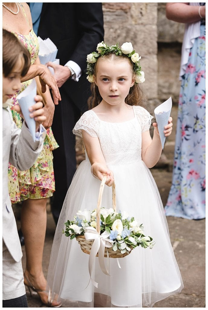 Cotswold Marquee Wedding flower girl holding her basket of flowers