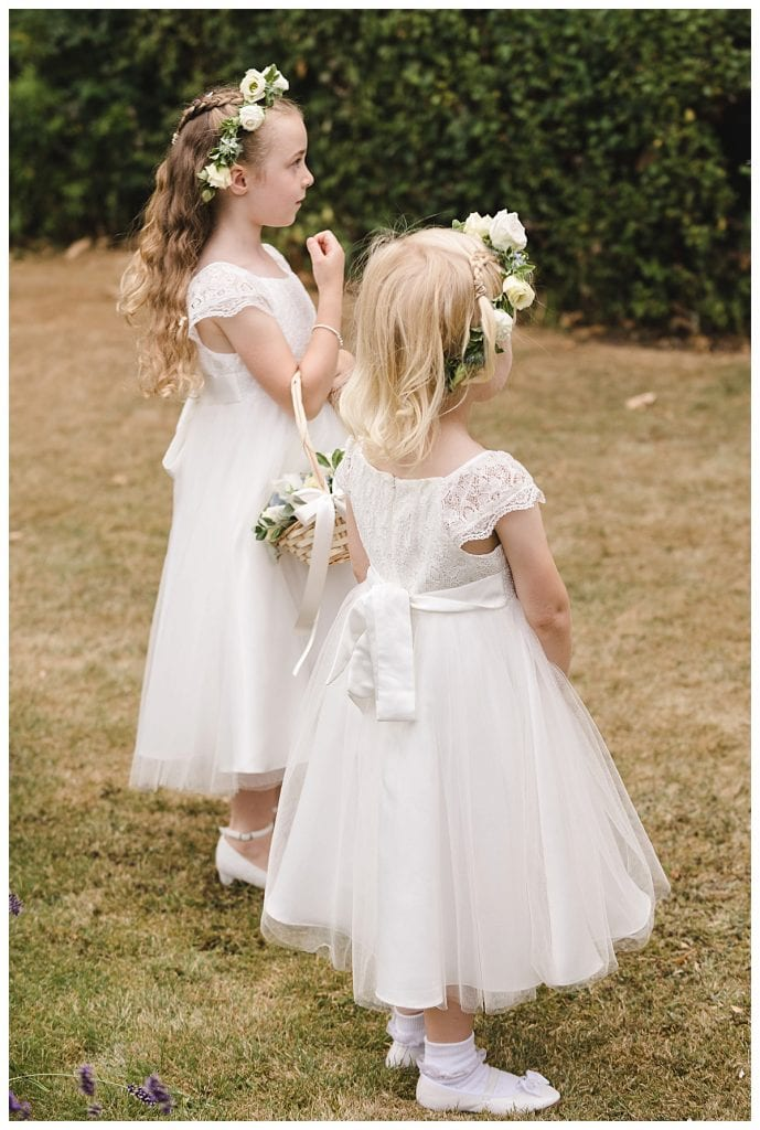 Cotswold Marquee Wedding Small flower girls wearing flower crowns and holding baskets