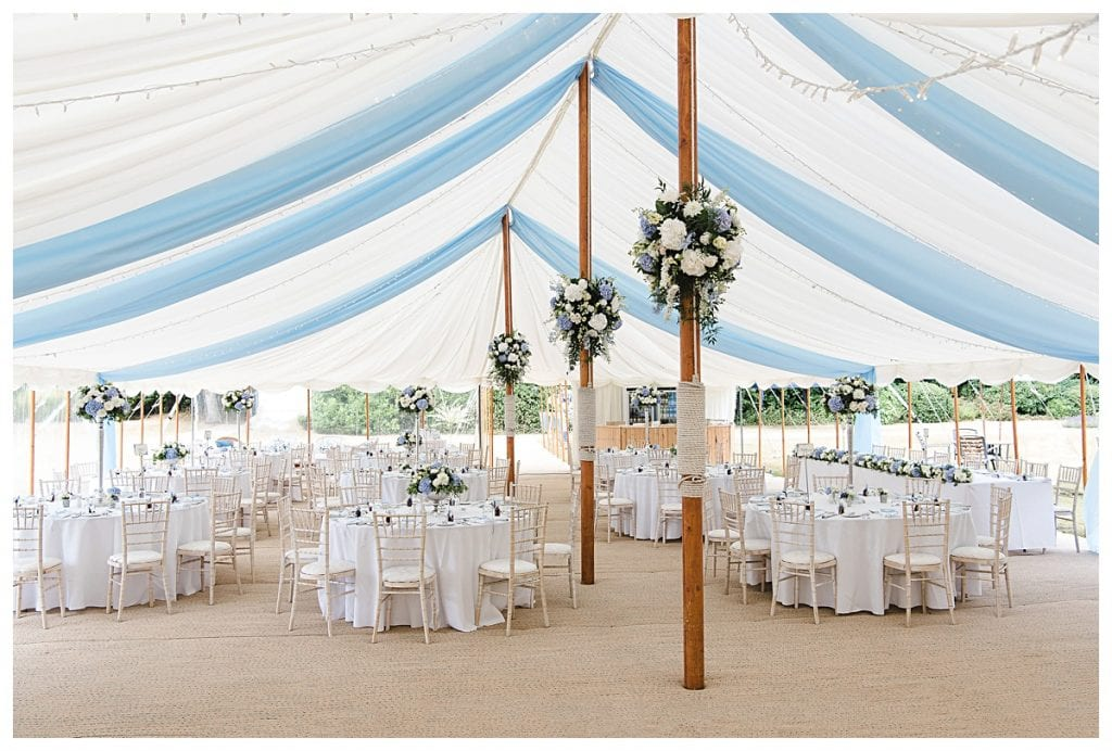 Poles decorated with flowers for a Cotswold Marquee Wedding in Blue and White flowers