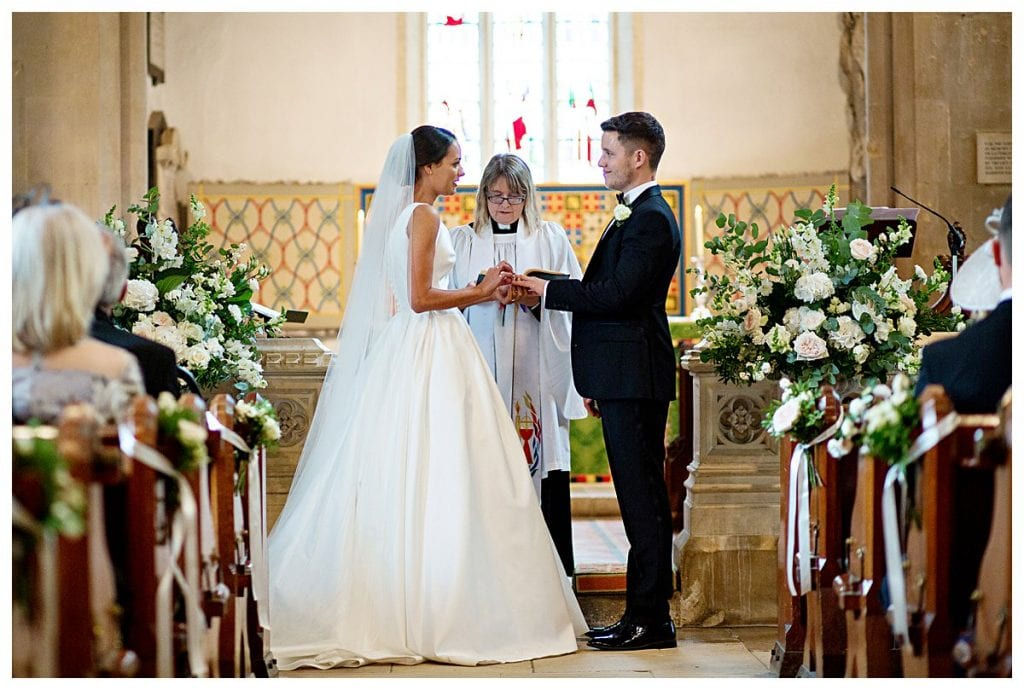 Bride and groom at the alter of Eastington Church, Eastington