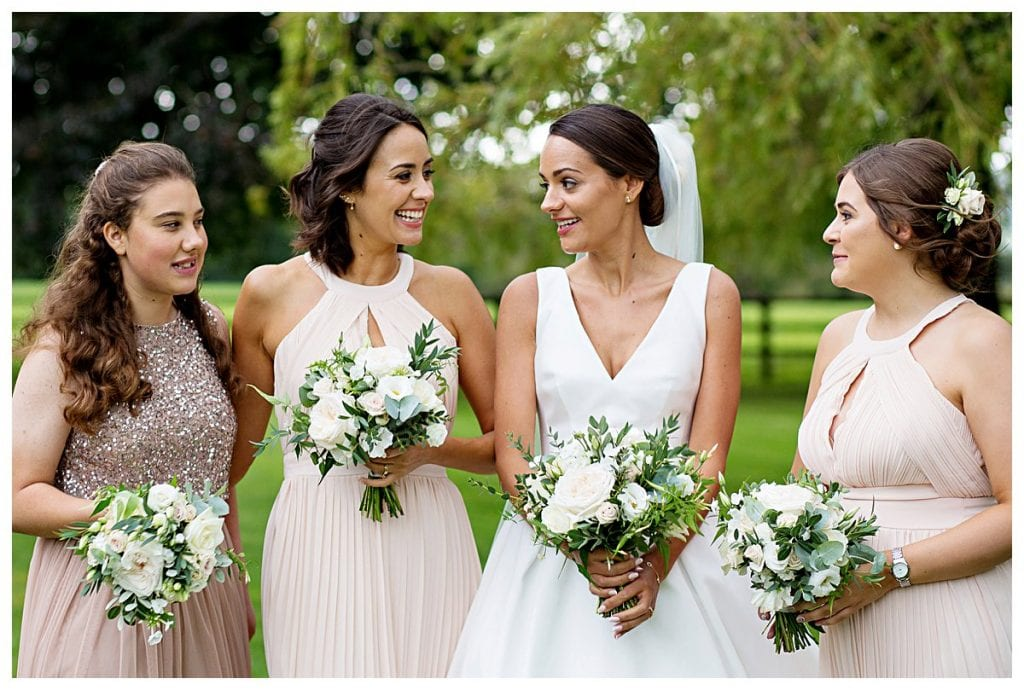 Bride and Bridesmaids with ivory and blush flowers