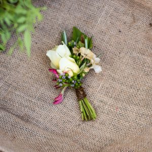 Cluster buttonholes for gents for a rustic wedding