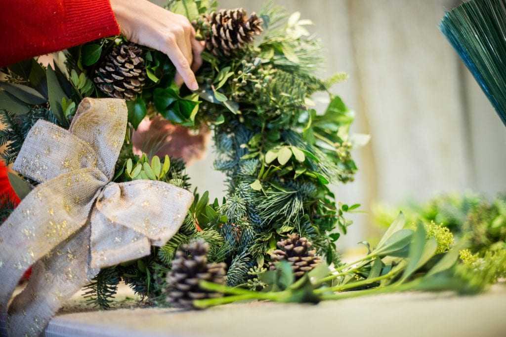 Adding cones Christmas wreath workshop