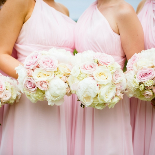 Pink bridesmaids with flowers
