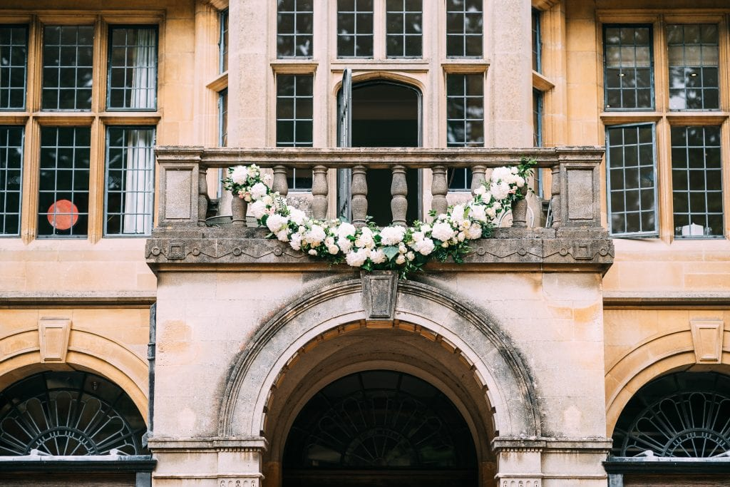 Coombe Lodge Summer wedding outdoor ceremony flowers