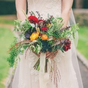 Rustic natural red orange bridal bouquet