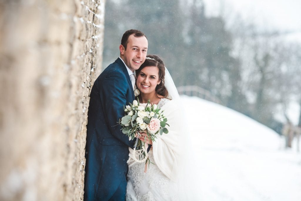 Snow wedding at Kingscote Barn