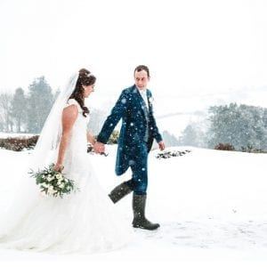 Snow wedding Kingscote Barn
